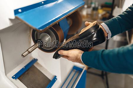 shoemaker, processes, women's, shoes, on, emery - 28062509
