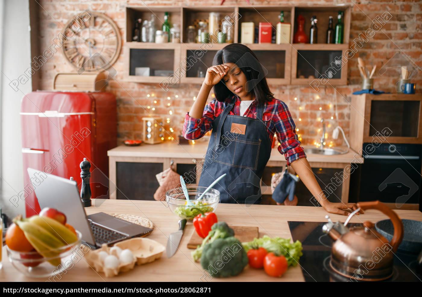 sleepy, black, woman, in, apron, cooking - 28062871
