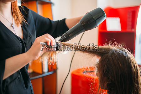stylist, drying, hair, with, a, dryer, - 28062393