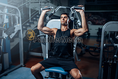 tanned, man, training, on, exercise, machine - 28062594