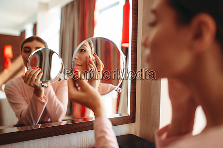 woman, doing, makeup, at, the, mirror, - 28062437