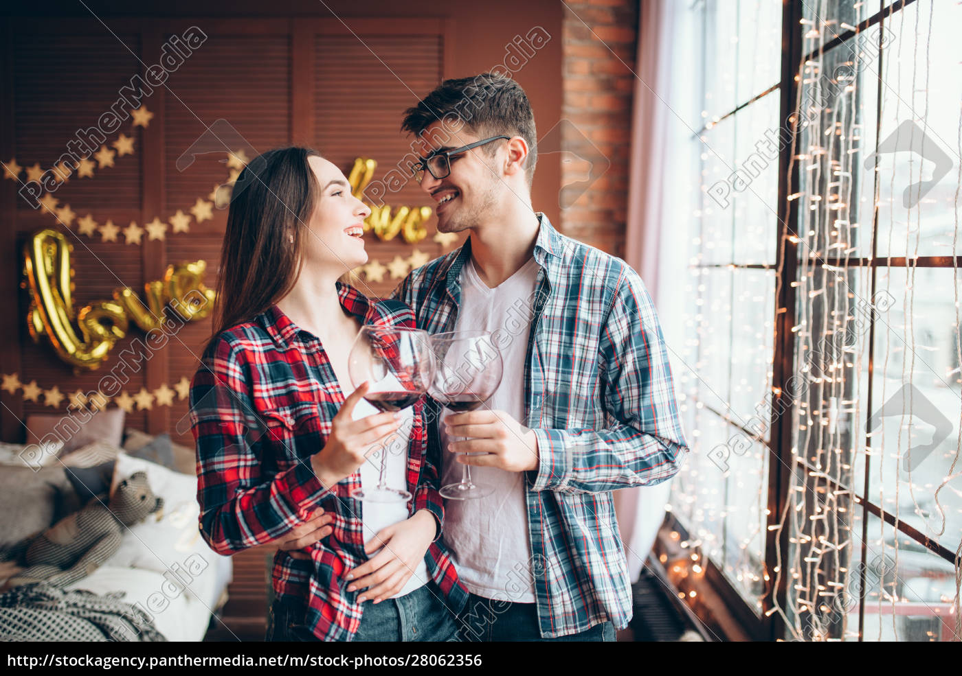young, couple, hugs, against, large, window - 28062356