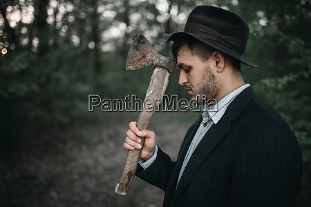 serial murderer with an axe bloody