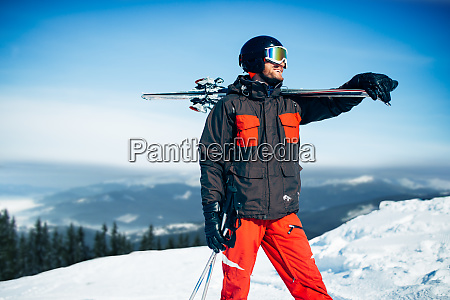skier with skis and poles in