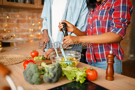 black, couple, cooking, together, on, the - 28063026