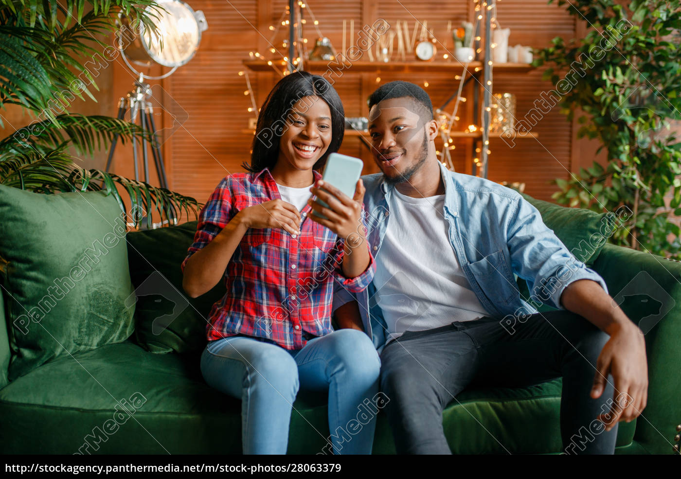black, couple, sitting, on, sofa, and - 28063379