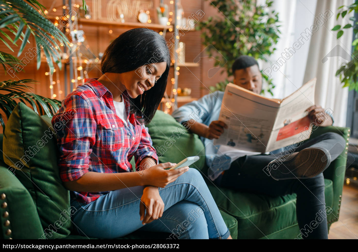 black, man, reading, newspaper, , his, woman - 28063372