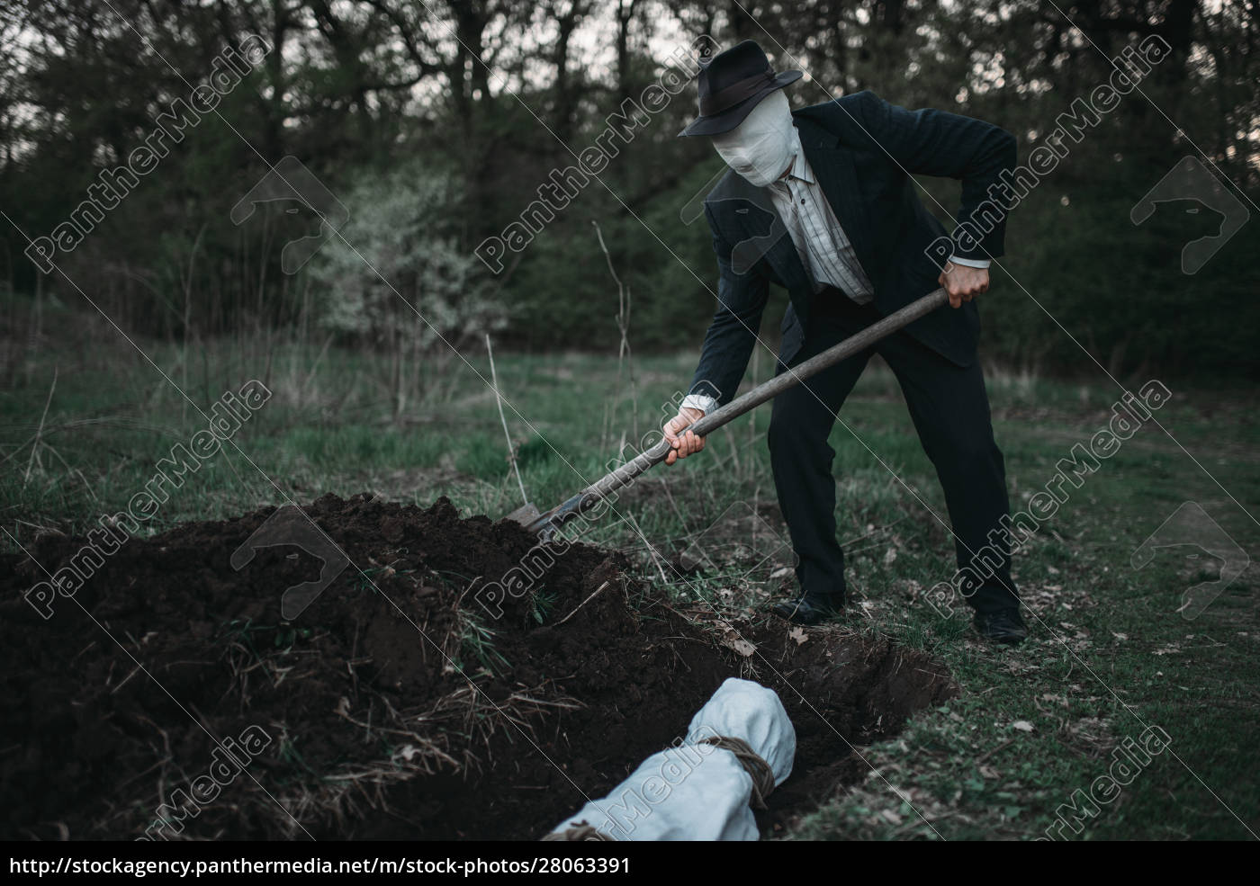 bloody, murderer, is, digging, a, grave - 28063391
