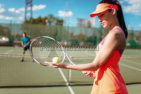 couple, playing, tennis, on, outdoor, court - 28063282