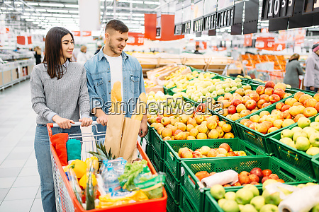 couple, with, cart, in, supermarket, , fruits - 28063359