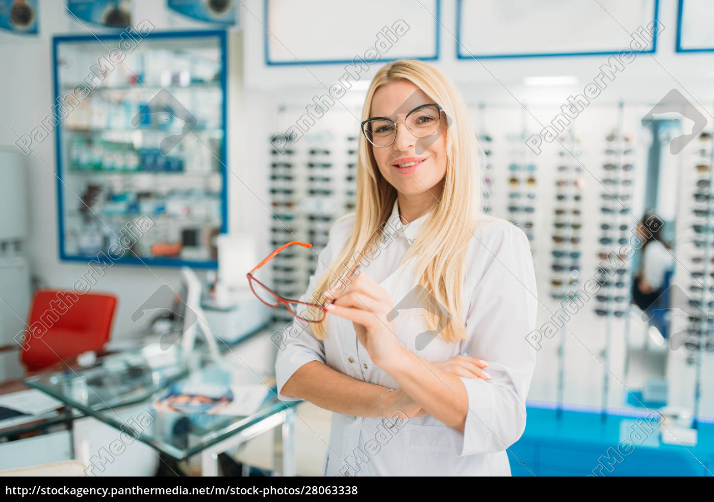 female, optometrist, holds, spectacles, in, hands - 28063338