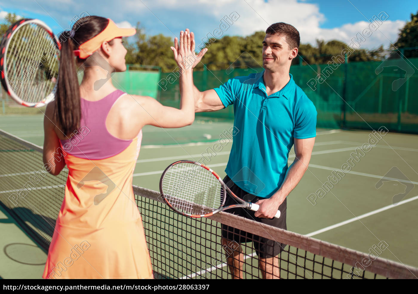 happy, couple, with, rackets, on, outdoor - 28063397