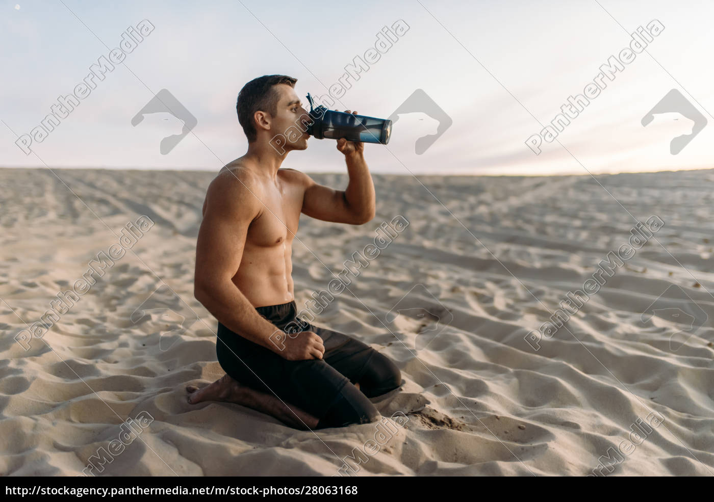 male, athlete, drinks, water, after, workout - 28063168