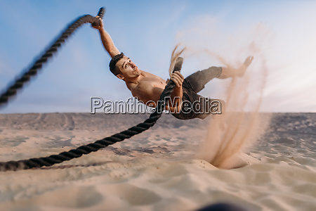 male, athlete, with, battle, ropes, , flying - 28063049