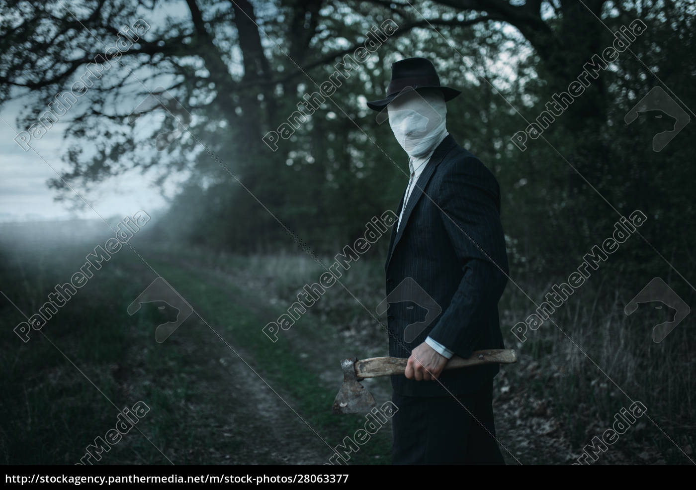 serial, maniac, with, axe, in, forest, - 28063377