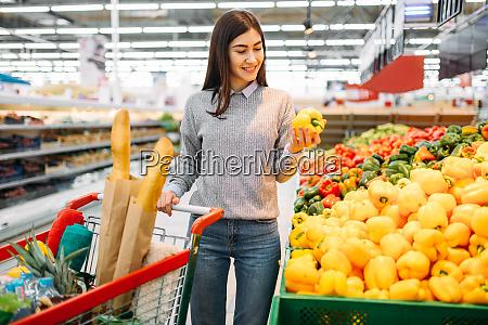 woman, choosing, fresh, sweet, yellow, peppers - 28063252
