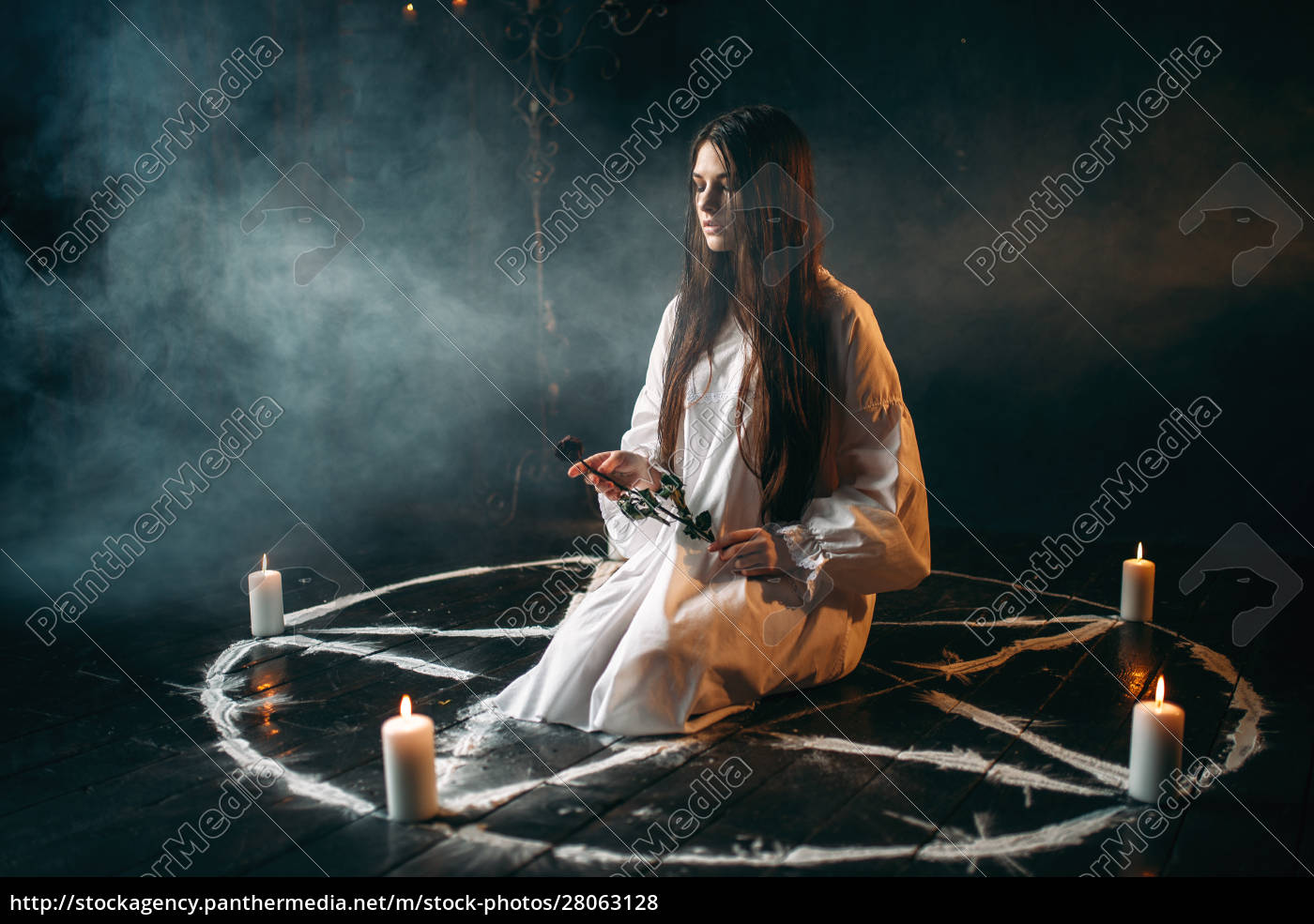 woman, holds, burnt, rose, in, hands, - 28063128