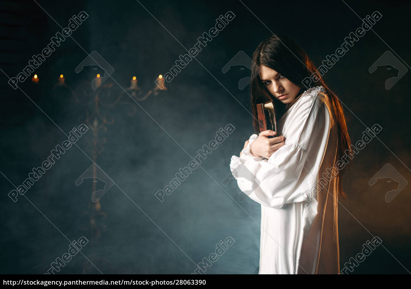 woman, holds, spellbook, in, hands, , witchcraft - 28063390