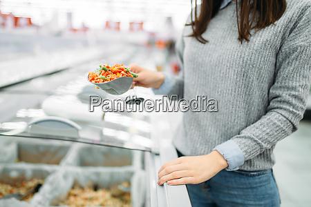 woman, picks, up, package, of, frozen - 28063370