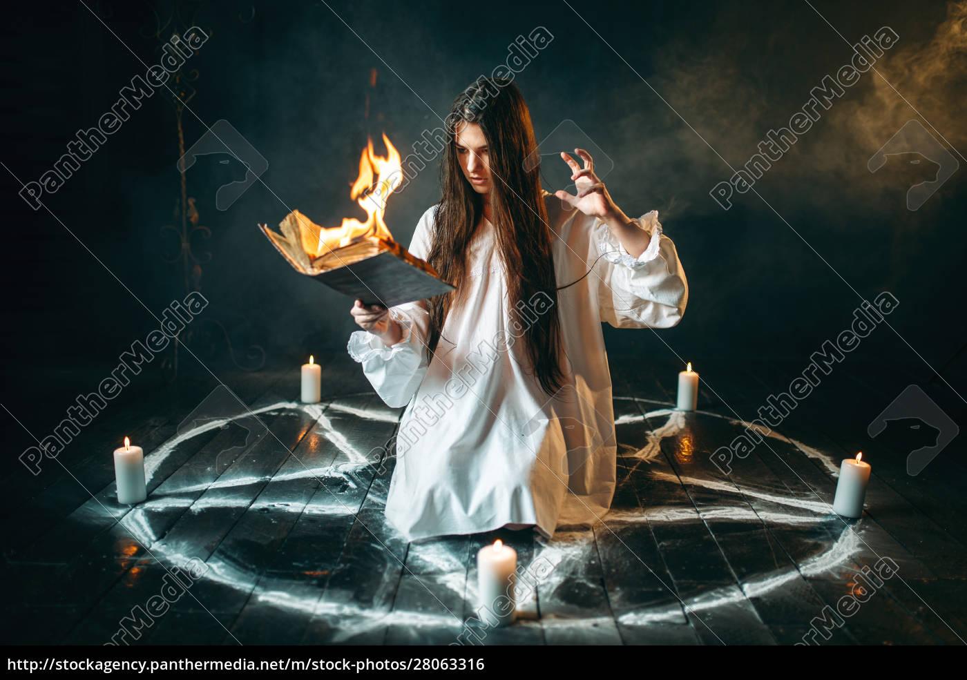 woman, sitting, in, burning, pentagram, circle, - 28063316