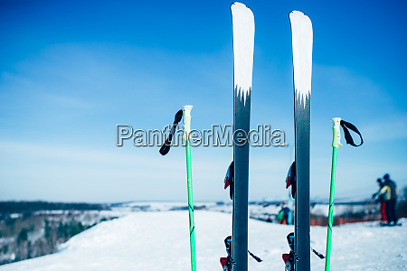 skis and poles sticking out of