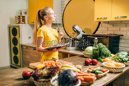 young woman cooking on recipes healthy