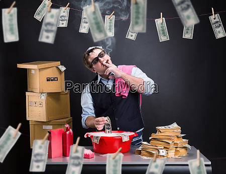 businessman is laundering money in the