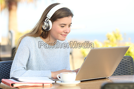 student e learning with headphones and
