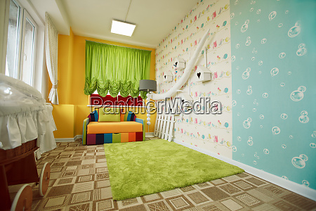 kindergarten room decorated with colorful sofa