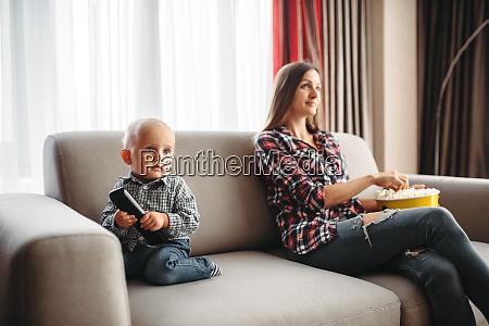 mother watch tv little male kid