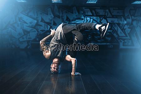 breakdance motions performer in dance studio
