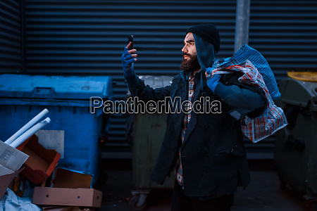 happy beggar found mobile phone in