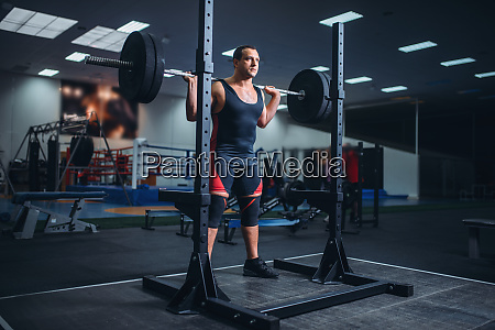 athlete prepares to make squats with