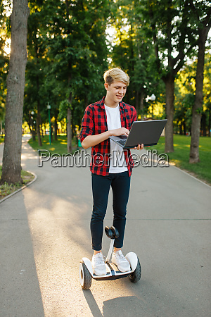 young man riding on mini gyro