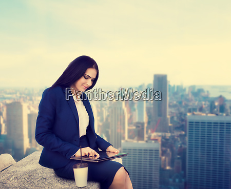 business woman working on the roof