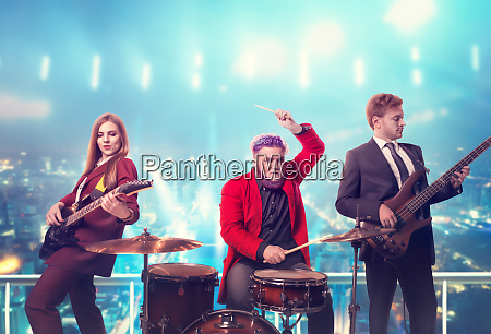 musical group in suits performing on