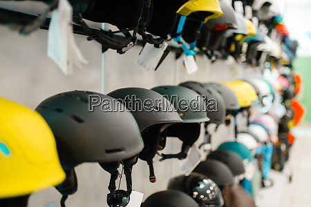 rows of ski and snowboarding helmets