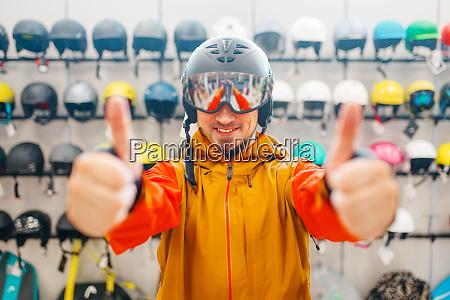 man in helmet for snowboarding shows