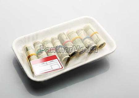 dollars in vacuum packaging