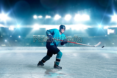 hockey player with stick and puck