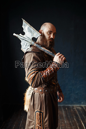 angry viking with axe barbarian image