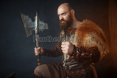 viking with axe barbarian side view