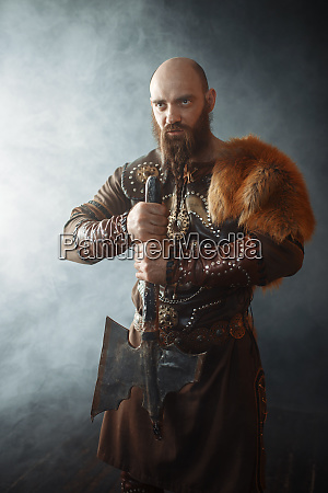 viking with axe nordic barbarian image