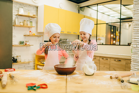 girls cooks cookies preparation on the