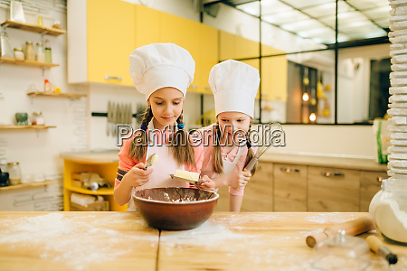 little girls cooks in caps adds