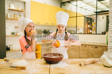 little girls cooks in caps rubs