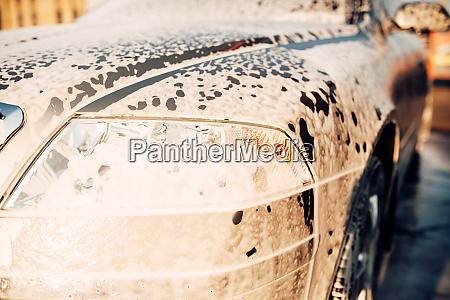 wet vehicle in foam automobile in