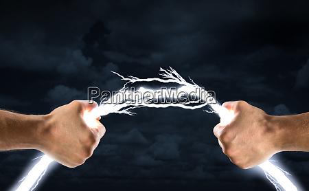hands bending lightning bolt