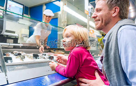 family at the fish counter in