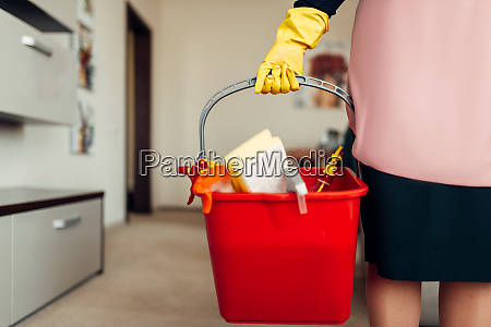 housemaid hands in gloves holds cleaning